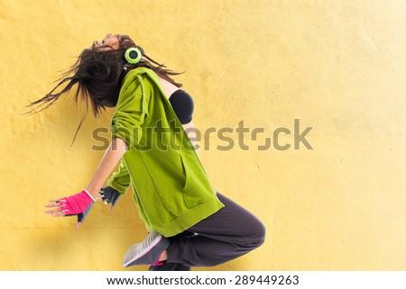 Teenager girl dancing street dance style - stock photo
