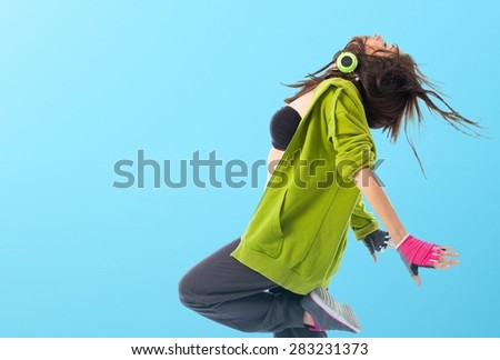 Teenager girl dancing street dance style over colorful background - stock photo