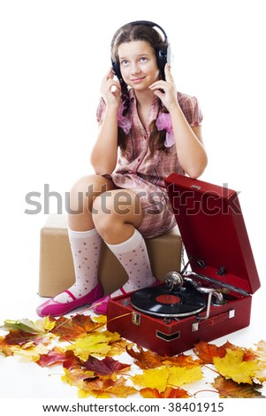 Teenager girl listen music sitting with maple leafs and old gramophone,isolated on white - stock photo