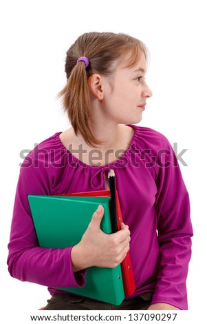 Teenager girl looking right, holding maps and pencils in her hand - stock photo