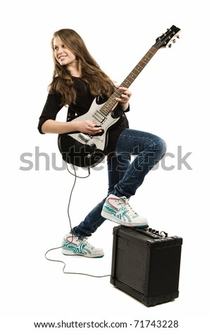 Teenager girl playing guitar against white background - stock photo