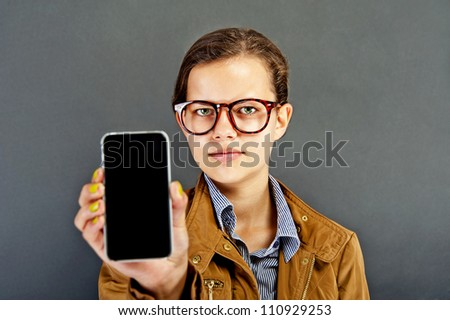 Teenager girl with mobile phone - stock photo
