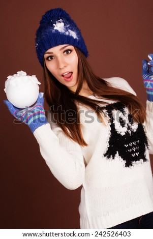 Teenager girl with snowball - stock photo