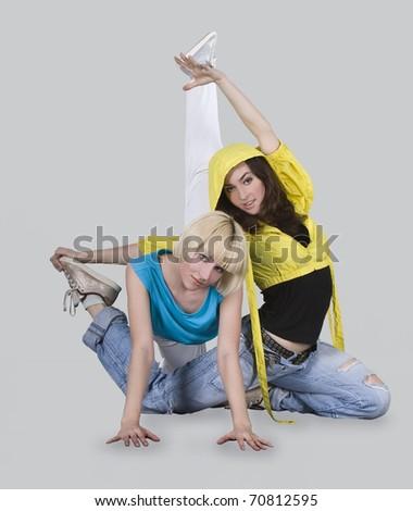 Teenager girls dancing breakdance in action - stock photo