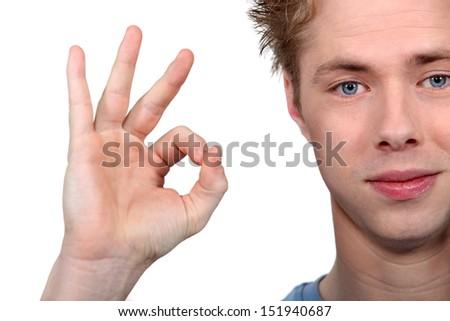 Teenager giving the OK - stock photo