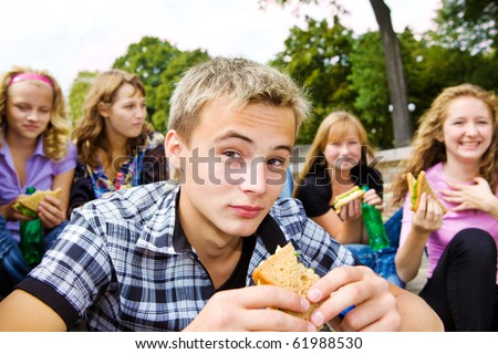 Teenager group with take-away food - stock photo