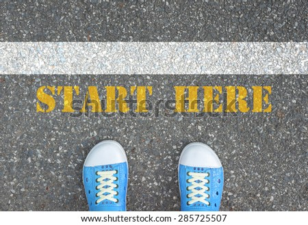 """Teenager in blue shoes standing at the line of """" start here """" to start or begin doing something new in his life - stock photo"""