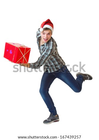Teenager in Santa Claus hat running with a gift isolated on white background - stock photo