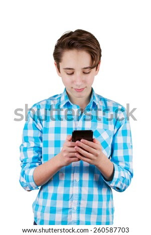 Teenager is typing a message in phone, isolated on white background - stock photo