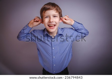 teenager laughing pulling her ears - stock photo