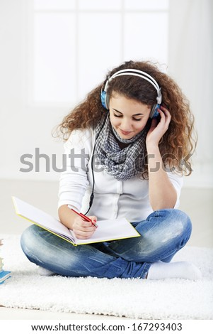 Teenager listening music - stock photo