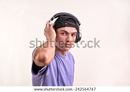 Teenager listening music with headphones - stock photo
