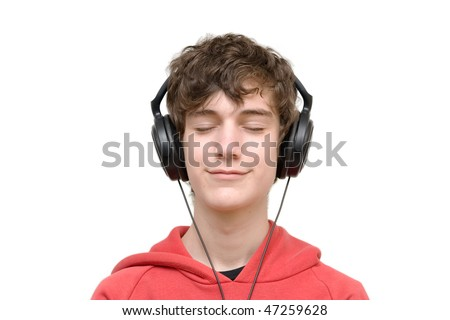 Teenager listening music with headphones, isolated on pure white - stock photo