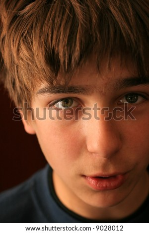 teenager looking into the camera and talking - stock photo