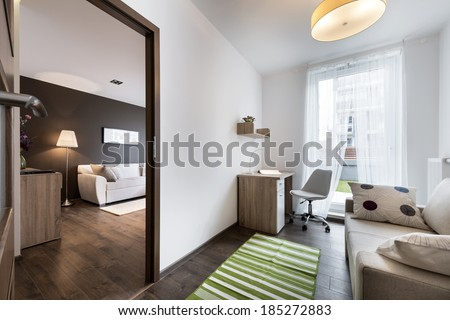 Teenager modern room with open doors to the living room  - stock photo