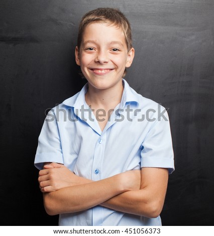 Teenager near blackboard. Child at school. Student at classroom - stock photo