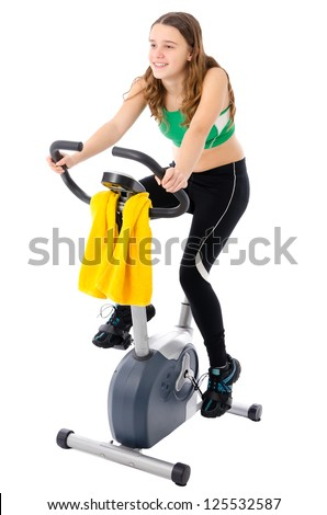Teenager on training bicycle - stock photo