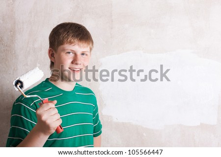 teenager painting the wall - stock photo