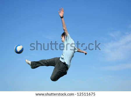 Teenager playing football - stock photo