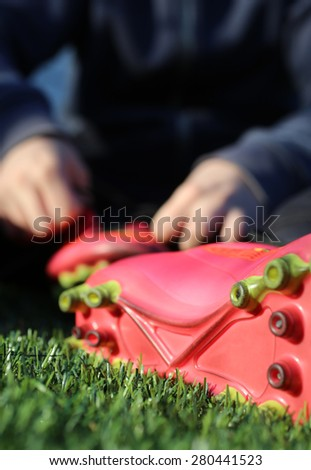Teenager playing football in the summer - stock photo