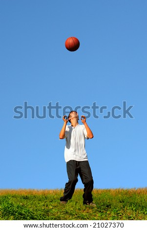 teenager playing in the basketball - stock photo