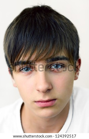 Teenager portrait on the White background closeup - stock photo