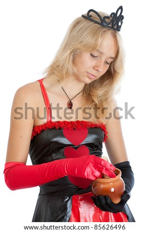 teenager princess girl in gloves and crown with a pot - stock photo
