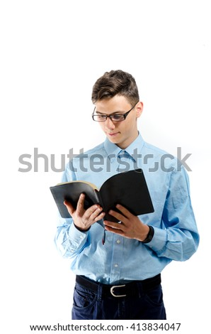 Teenager read and study from black book with eyeglasses isolated on white - stock photo