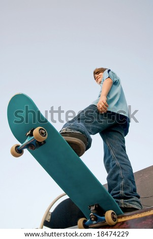 Teenager Skateboarding - stock photo