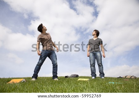Teenager students outside looking up to the sky - stock photo