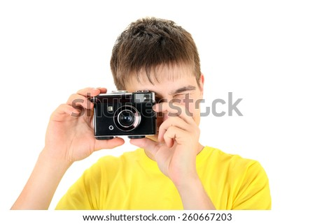 Teenager Take a Picture with Vintage Photo Camera Isolated on the White - stock photo