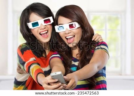 Teenager watching a 3D movie with retro 3D glasses - stock photo