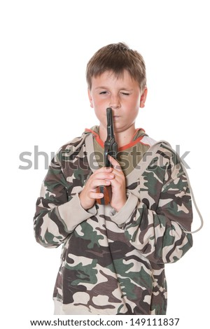 teenager with a gun on a white background - stock photo