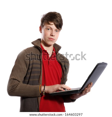 Teenager with a personal computer on a white background - stock photo
