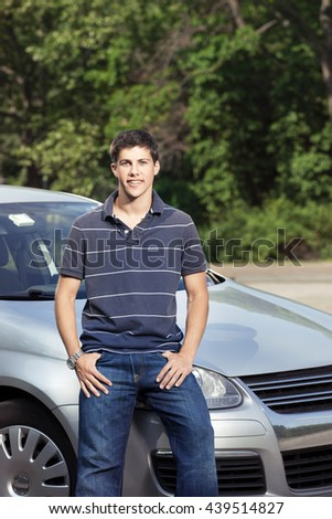 Teenager with car - stock photo