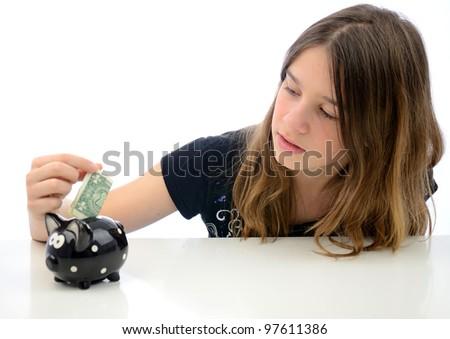 Teenager with dollar savings - stock photo