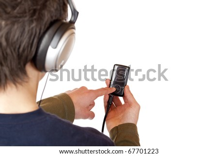 Teenager with headset use mp3 music player. Isolated on white background. - stock photo