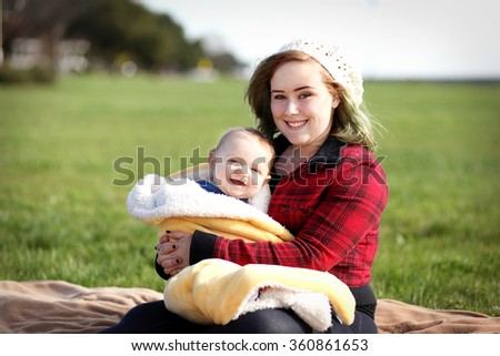 Teenager with her baby boy. - stock photo