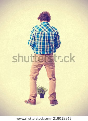 teenager with plant and urinate gesture - stock photo