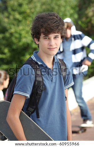Teenager with skateboard - stock photo