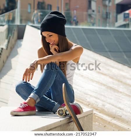 Teenager with skateboard portrait outdoors. - stock photo