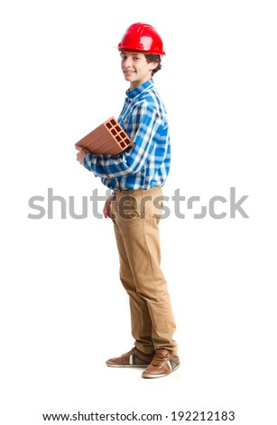 teenager with work helmet and holding a brick. isolated - stock photo