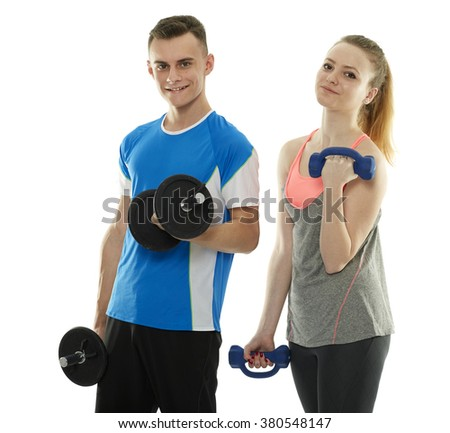 Teenagers boy and girl doing a fitness workout with dumbbells - stock photo