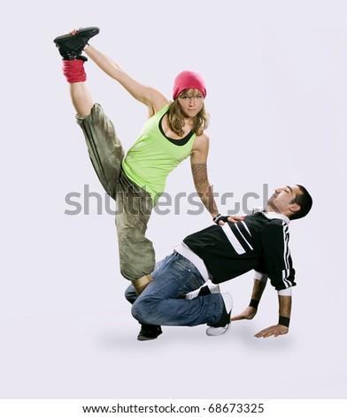 Teenagers dancing breakdance in action - stock photo