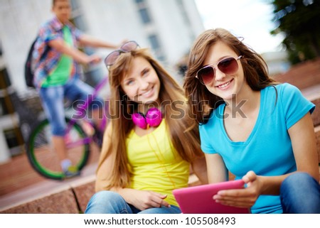 Teenagers hanging out together on a usual summer day, selective focus - stock photo