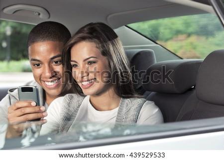 Teenagers in car - stock photo