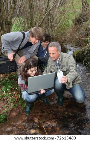 Teenagers in environmental professional training - stock photo