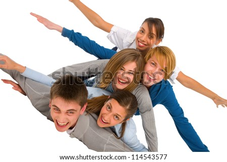 teenagers laying in pile - stock photo