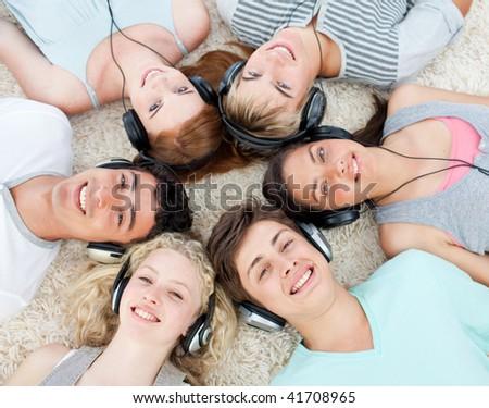 Teenagers listening to music - stock photo