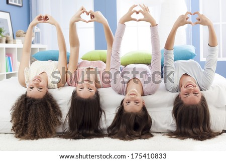 Teenagers making hearth shape with their hands - stock photo